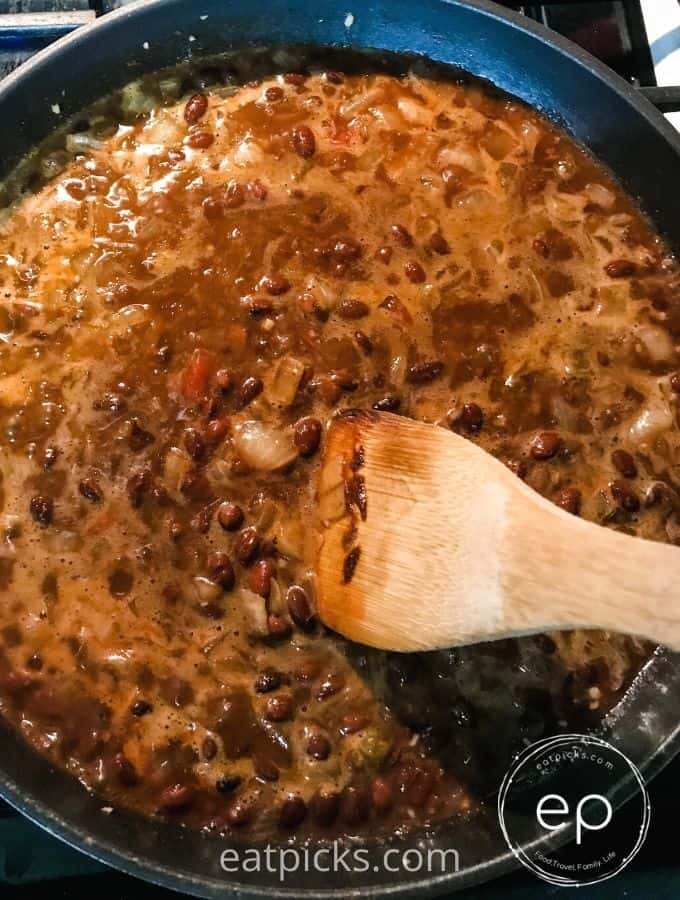 Black bean burrito mixture cooking in a frying pan