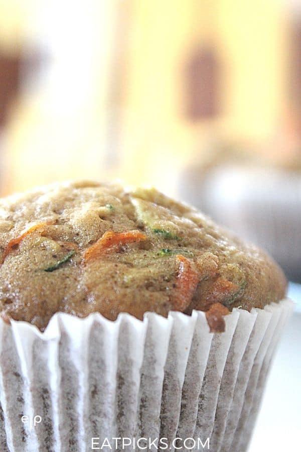 zucchini carrot muffins in paper liner