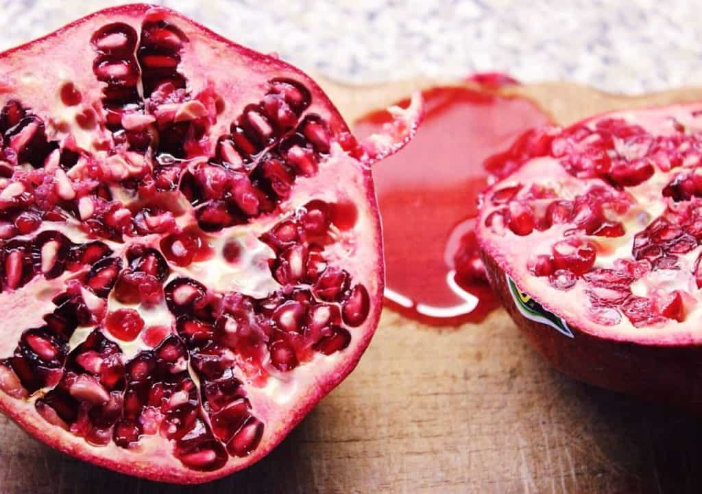 open pomegranate fruit with seeds