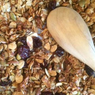 Granola is super easy to make at home! This DIY breakfast recipe is full of fruit, oats, nuts and seeds and goes great with milk or over yogurt!