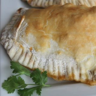 empanadas on plate with cilantro