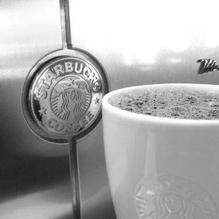 starbucks mug with machine black and white