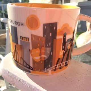 Coffee cup on porch chair
