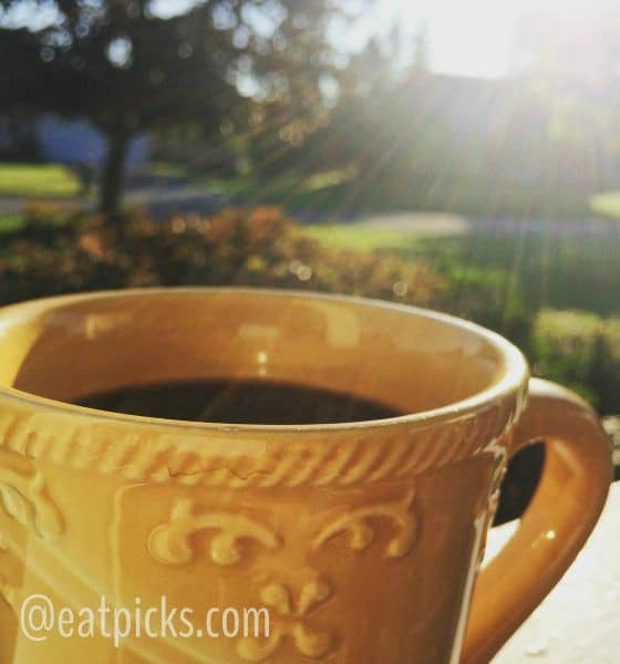 coffee cup on porch with sunshine