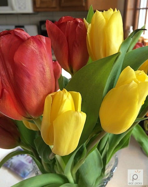 Fresh tulips in a vase is the perfect flower arrangement to welcome Easter morning and brighten up the day while making your favorite recipes!