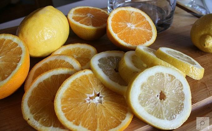 orange and lemon slices on cutting board