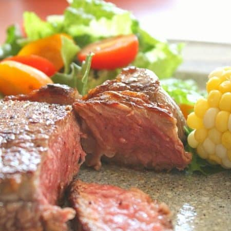 cut beef steak on plate