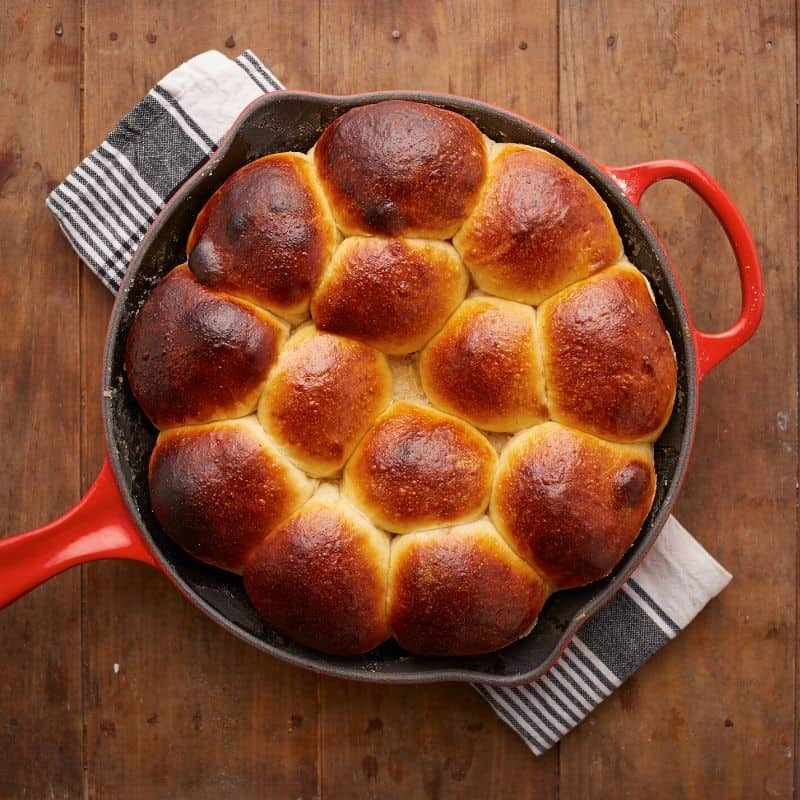 Brioche buns in cast iron skillet