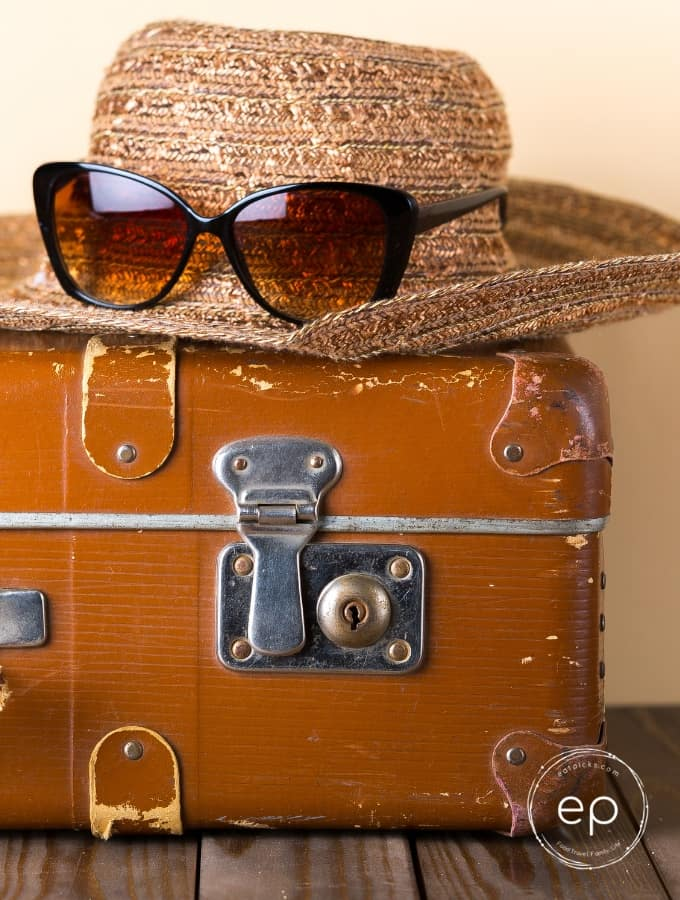 Hat on suitcase travel