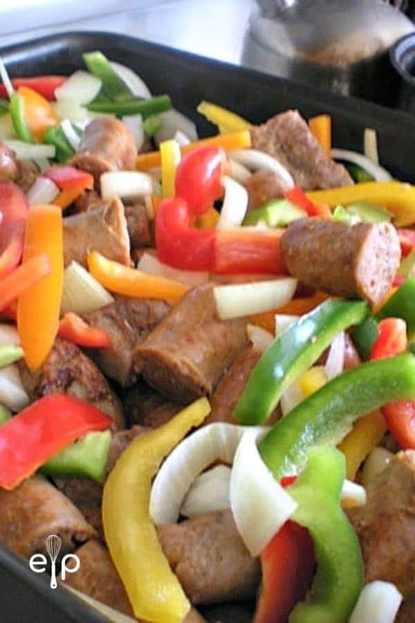 Sausage links with cut peppers and onions
