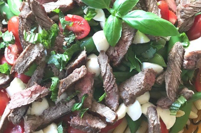Sirloin steak and pasta salad with basil, mozzarella cheese, tomatoes and lemon vinaigrette