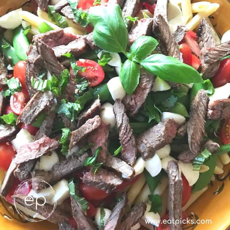 Sirloin steak and pasta salad with basil, mozzarella cheese, tomatoes and lemon vinaigrette