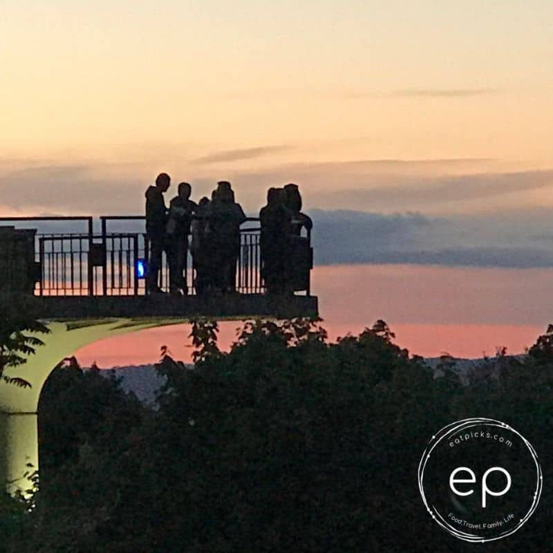 Tourists at sunset on lookout on Grandview Ave in Pittsbrgh