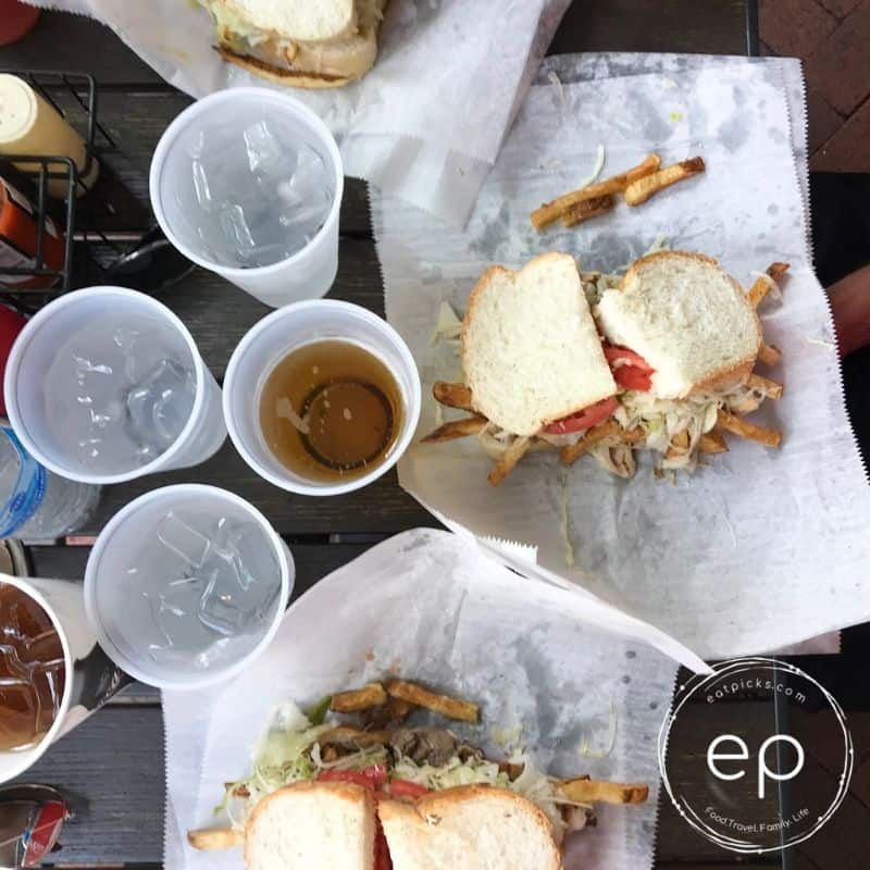 Primanti Brothers sandwich on table with waters