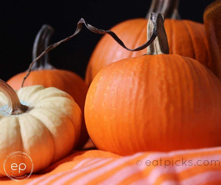 Pumpkins on table with orange cloth
