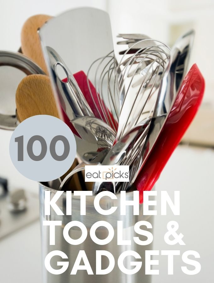 Kitchen tools and gadgets in crock on counter