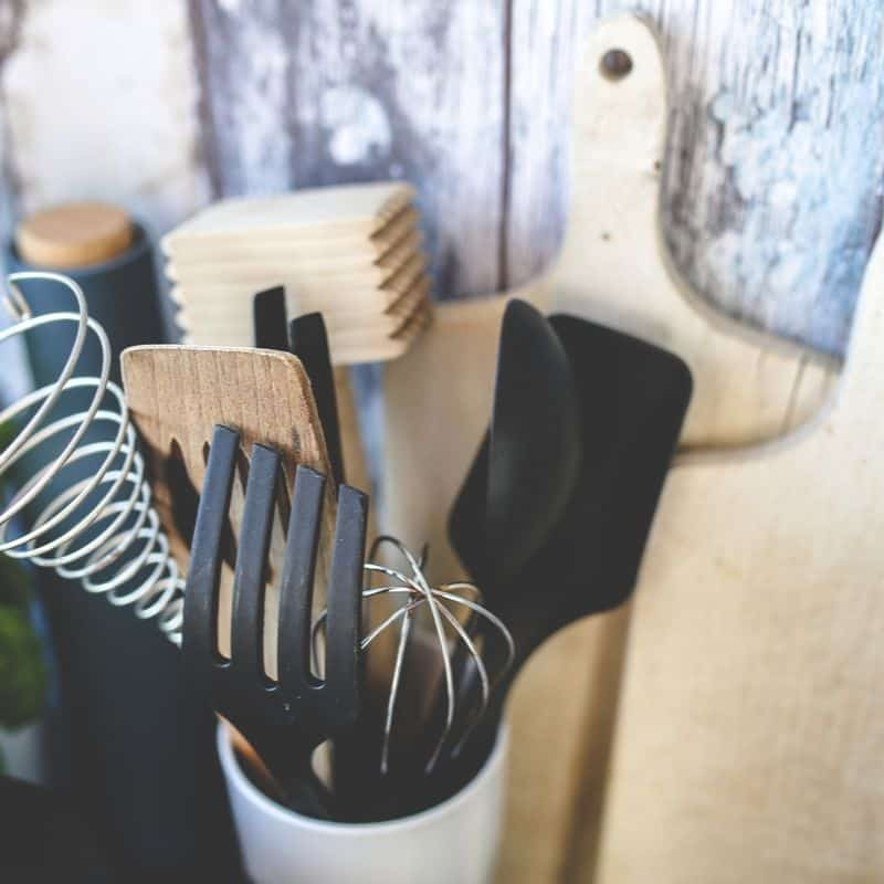 Multiple Kitchen Cooking Utensils in crock with cutting boards