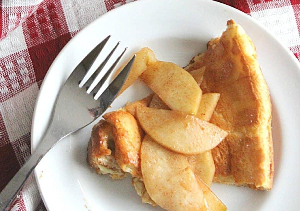 Dutch baby apple pancake slice on plate