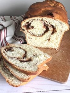 homemade cinnamon swirl bread loaf with slices