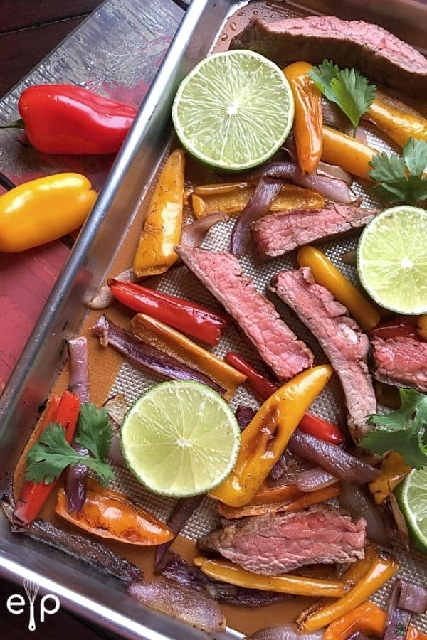 Steak fajitas on sheet pan with lime