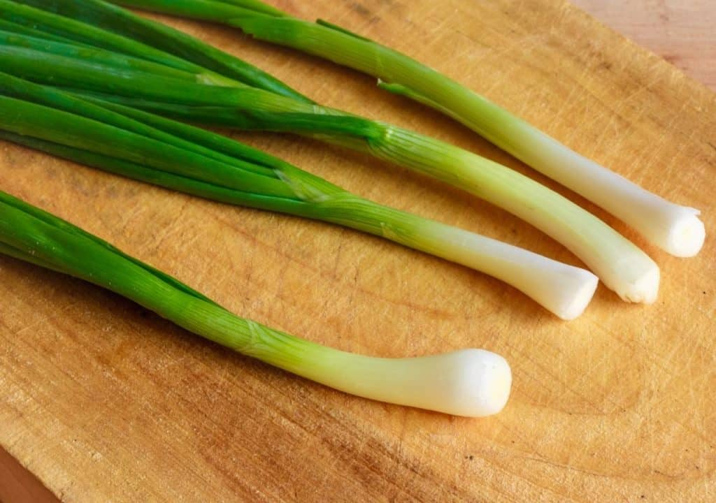 green onions on board